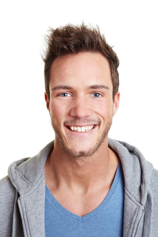 Tiro principal do homem de sorriso feliz foto de stock