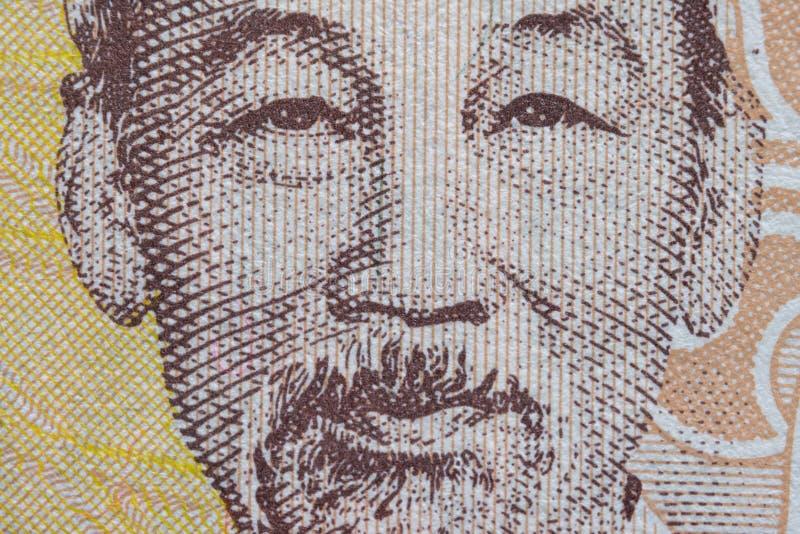 Tiro ultra macro del retrato de Ho Chi Minh del billete de banco vietnamita del dinero imagen de archivo