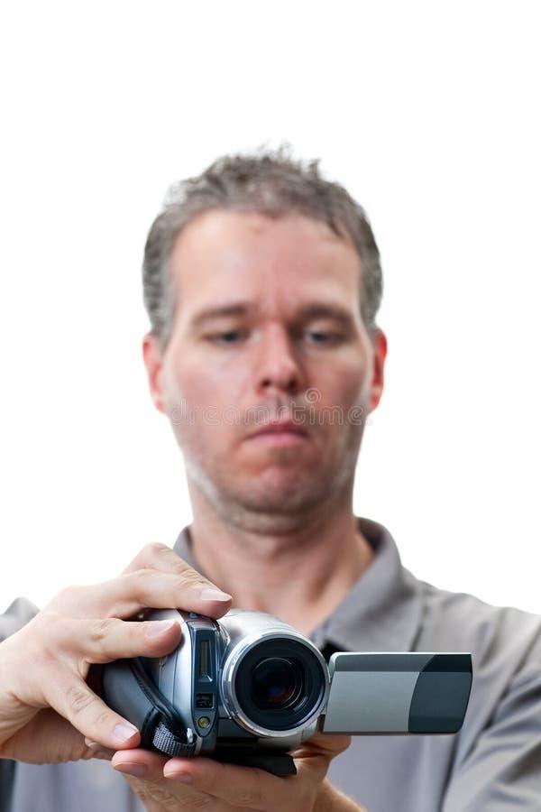 Tiroteo del hombre con una cámara de vídeo foto de archivo