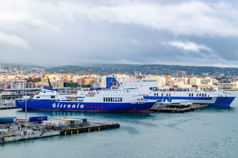 Tirrenia Hartmut Puschmann Ro-Ro Cargo and Passenger Ship and Eurocargo Bari Ro-Ro Cargo Ship Grimaldi Lines. Civitavecchia, Italy - November 5, 2018: Tirrenia stock photography