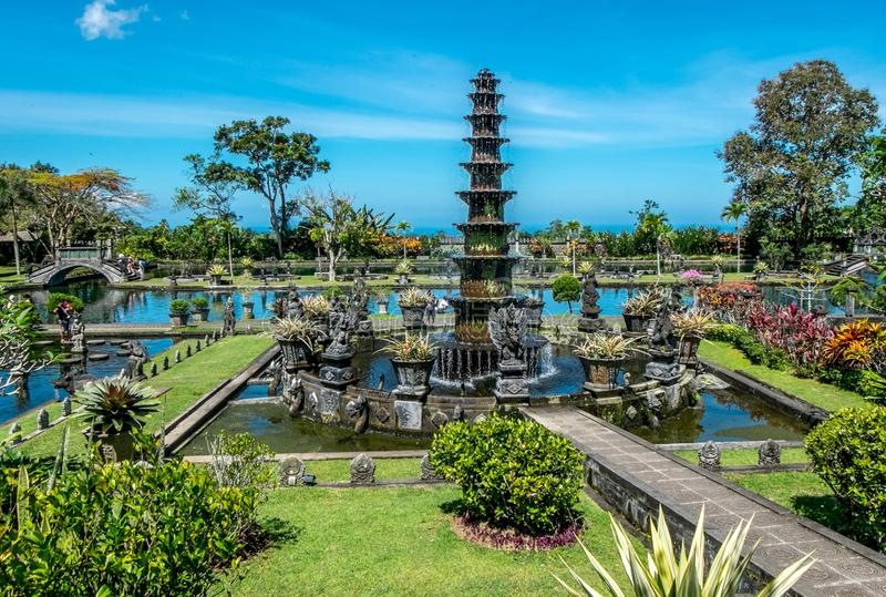 Tirta Gangga, Water Palace with fountain and natural pond. Travel and architecture background. Indonesia, Bali island. Tirta Gangga, Water Palace with fountain royalty free stock photography