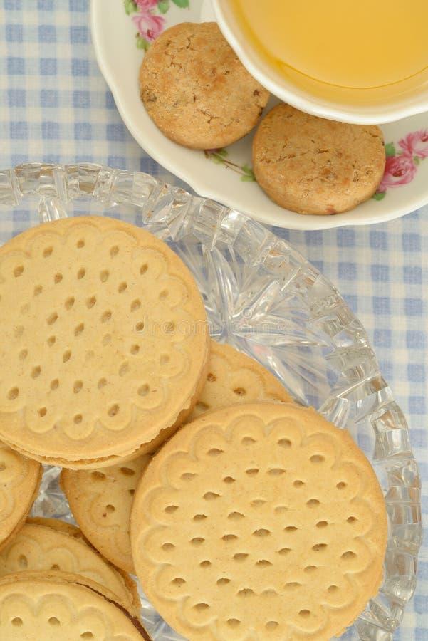 Tisana e tempo enchido do chá das cookies foto de stock royalty free