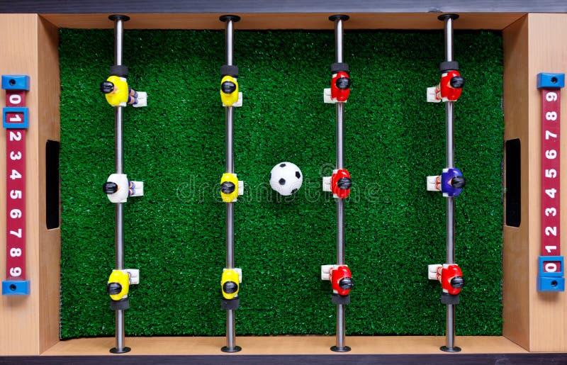 Tischfußballfußballkicker-Spielspieler stockfoto