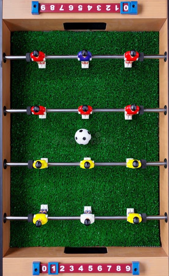 Tischfußballfußballkicker-Spielspieler lizenzfreies stockbild