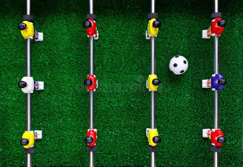 Tischfußballfußballkicker-Spielspieler lizenzfreie stockfotos