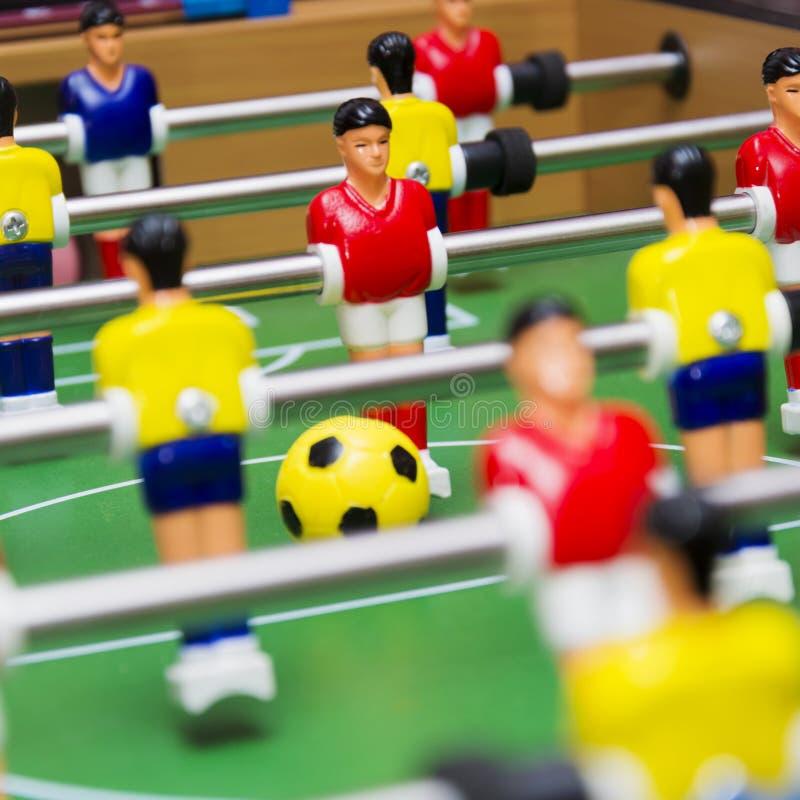 Tischfußballfußballspiel, Abschluss oben lizenzfreies stockbild