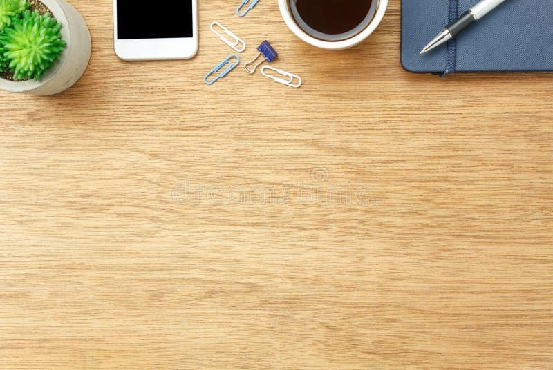 Tischplatteansicht-Luftbild stationär auf Schreibtischhintergrund lizenzfreie stockfotografie