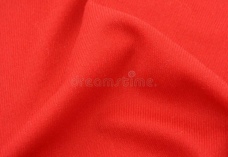 Tissu de coton rouge avec le pli image libre de droits