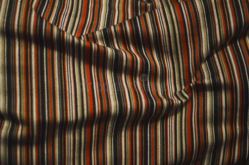 Tissu de couleur chaude et rayé photo stock