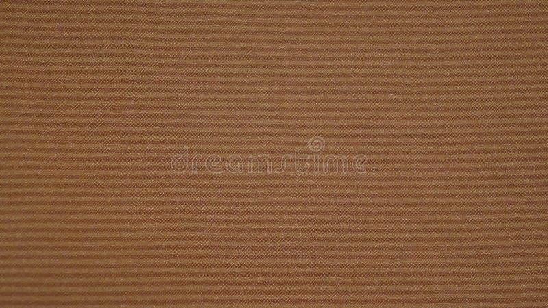 Tissu de tissu d'or avec le fond abstrait de rayures photos stock