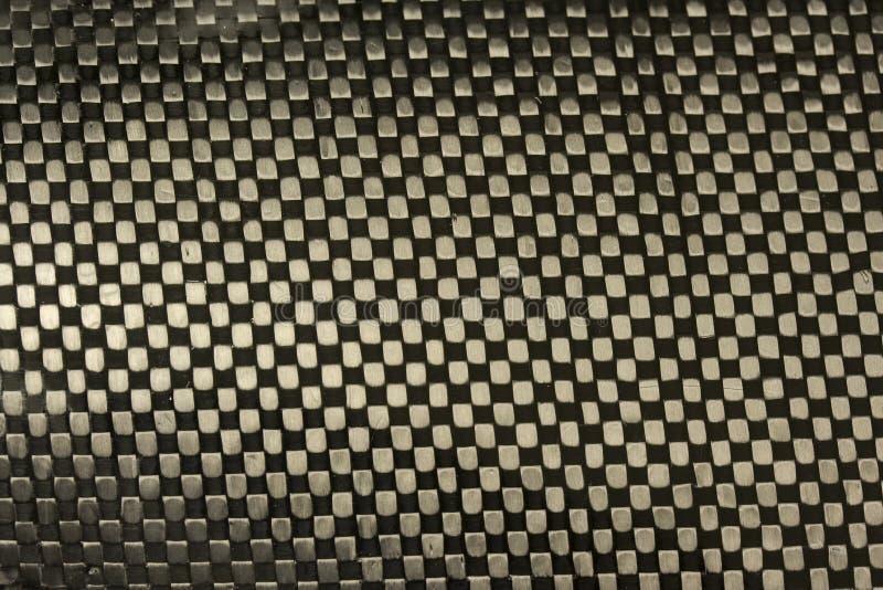 Tissu de fibre de carbone avec le fond de résine époxy photographie stock