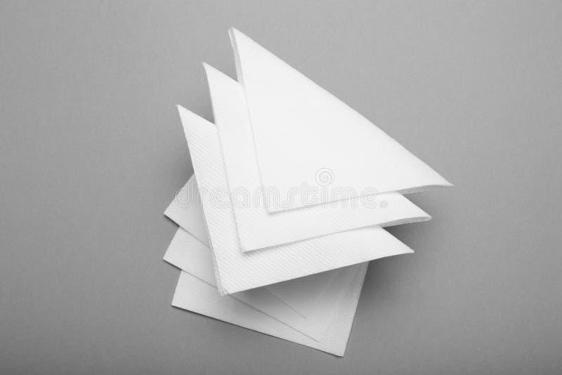 Tissu de restaurant, maquette de serviette de livre blanc photos stock