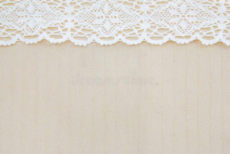 Tissu de sac et dentelle blanche photo libre de droits