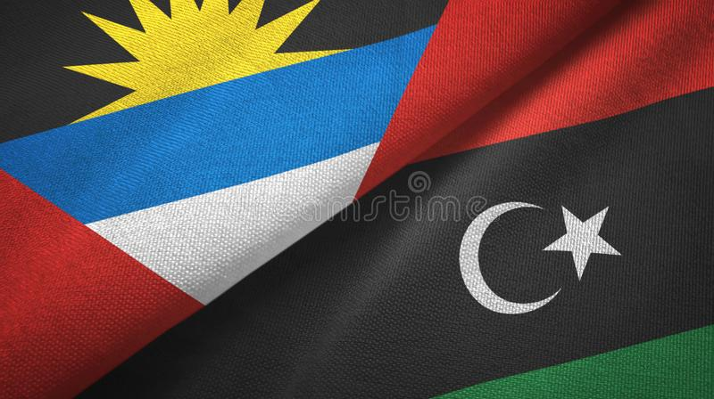 Tissu de textile de drapeaux de l'Antigua-et-Barbuda et de la Libye deux, texture de tissu illustration libre de droits
