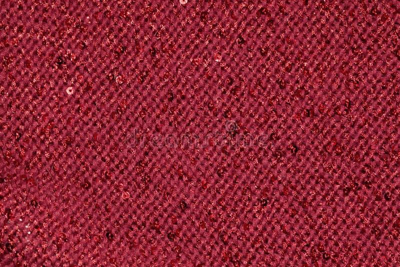 Tissu de textile rouge avec des paillettes comme fond images libres de droits
