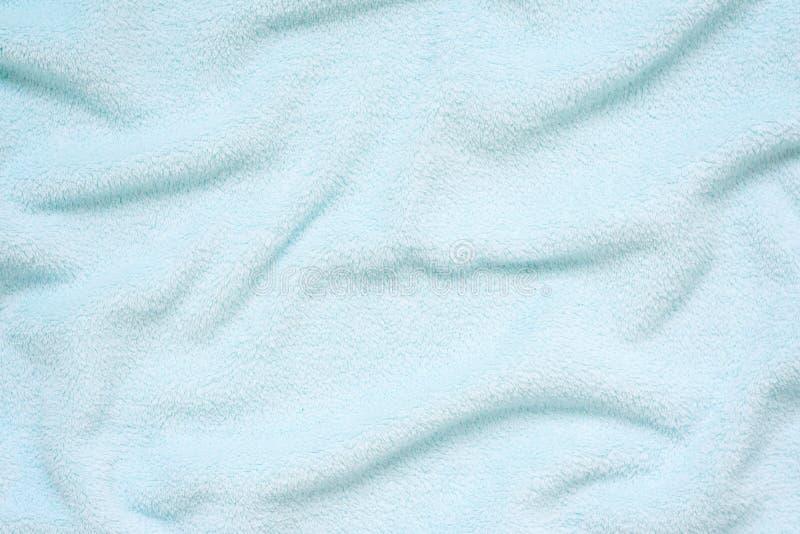 Tissu doux pelucheux de bleus layette Texture en pastel douce de textile Plis sur le tissu mou Tissu de Terry bleu d'essuie-main image stock