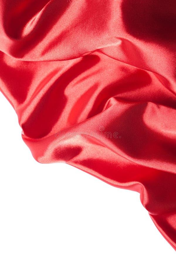 Tissu en soie rouge au-dessus du fond blanc photo libre de droits
