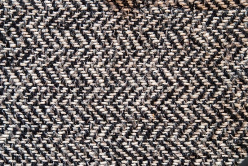 Tissu gris-clair de laine ou de tweed pour le fond grunge image stock