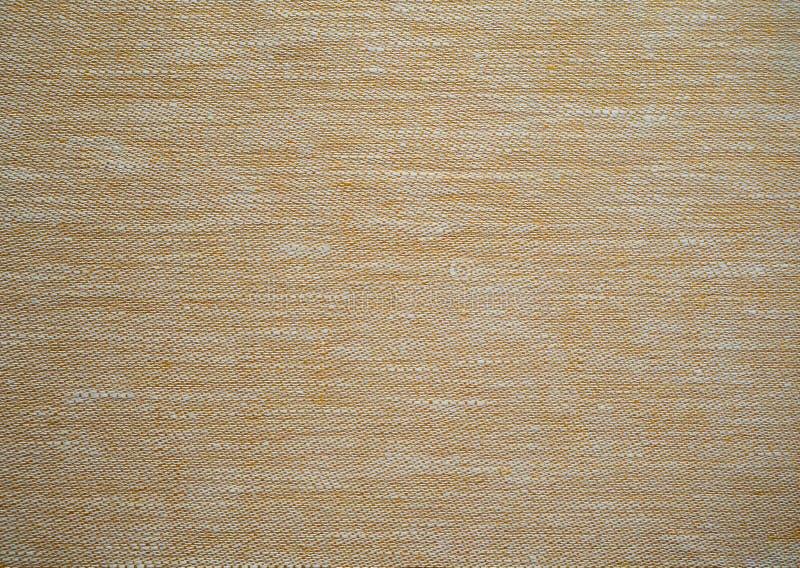 Tissu jaune de toile de texture Donnez au tissu une consistance rugueuse de toile image stock