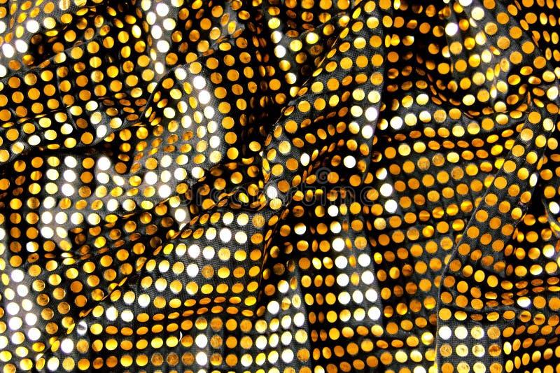 Tissu noir avec des paillettes d'or photographie stock libre de droits