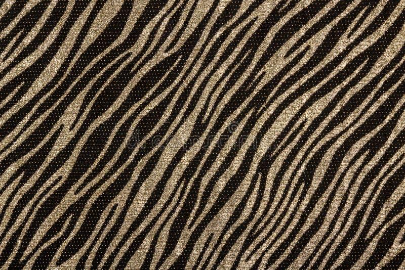 Tissu noir avec le modèle d'or de zèbre photographie stock
