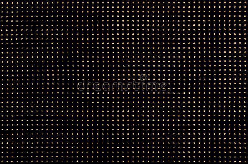 Tissu noir avec les points métalliques d'or photos stock