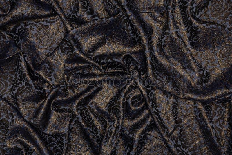 Tissu noir créatif avec les modèles floraux image stock