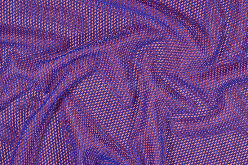 Tissu non-tissé chiffonné par bleu sur une orange images libres de droits