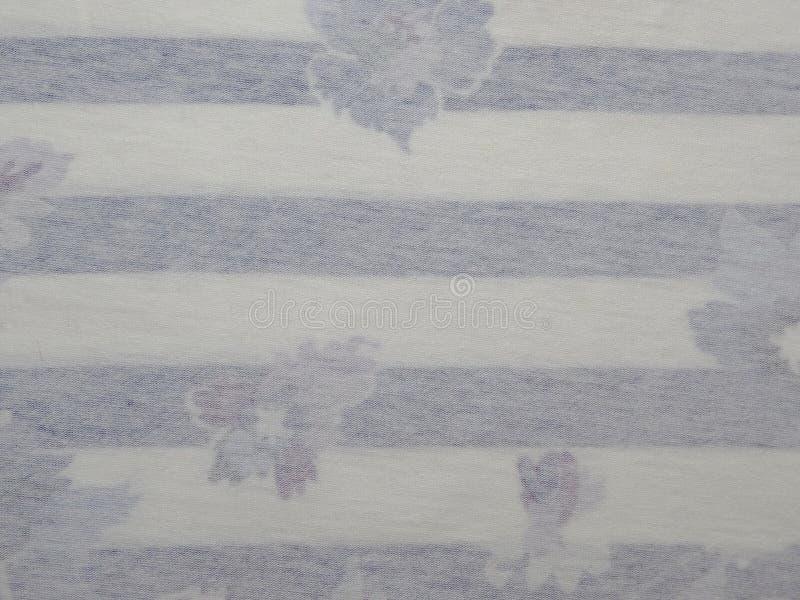 Tissu rayé avec des dessins photos stock