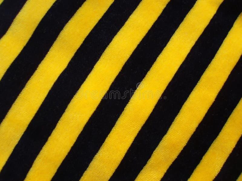 Tissu rayé noir et jaune image libre de droits