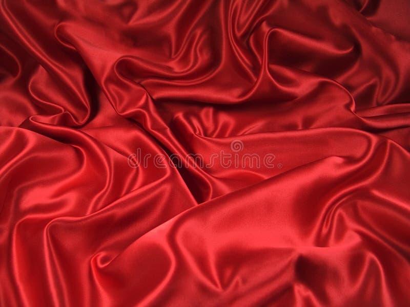 Tissu rouge de satin [horizontal] photos stock