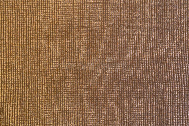 Tissu texturisé d'or brillant avec le macro tir de modèle carré pour images stock