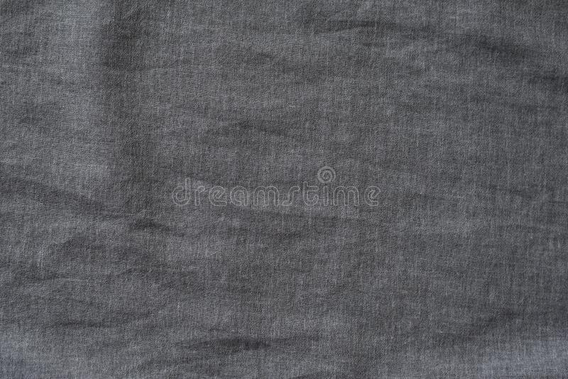 Tissu texturisé gris-foncé Plan rapproché Fond photos stock