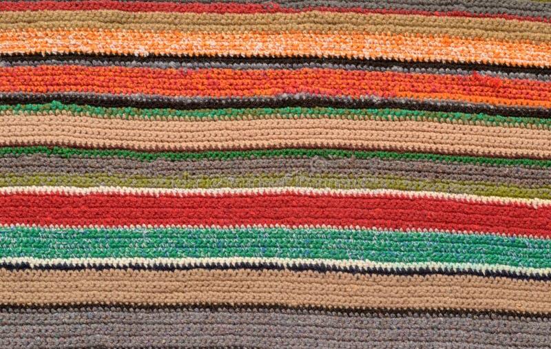 Tissu tricoté avec le fond de rayures photos libres de droits