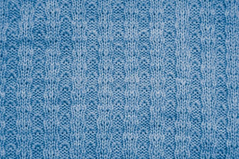 Tissu tricoté par bleu comme fond Macro photographie stock