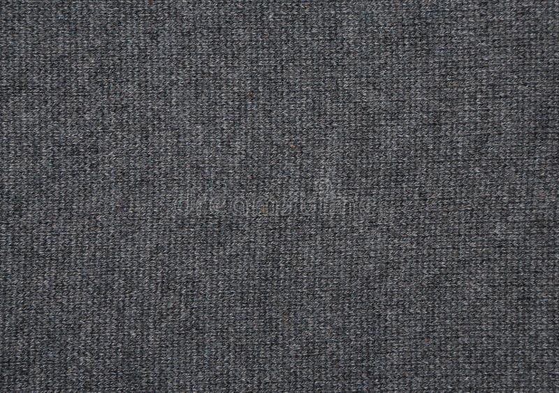 Tissu tricoté par gris photo stock
