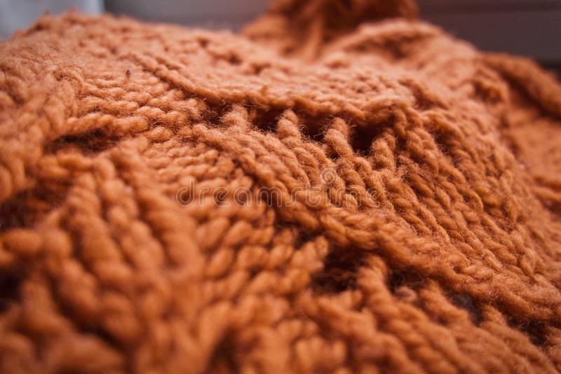 Tissu tricoté par orange grosse photo stock
