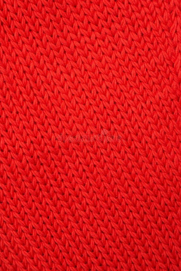 Tissu tricoté rouge. photo stock