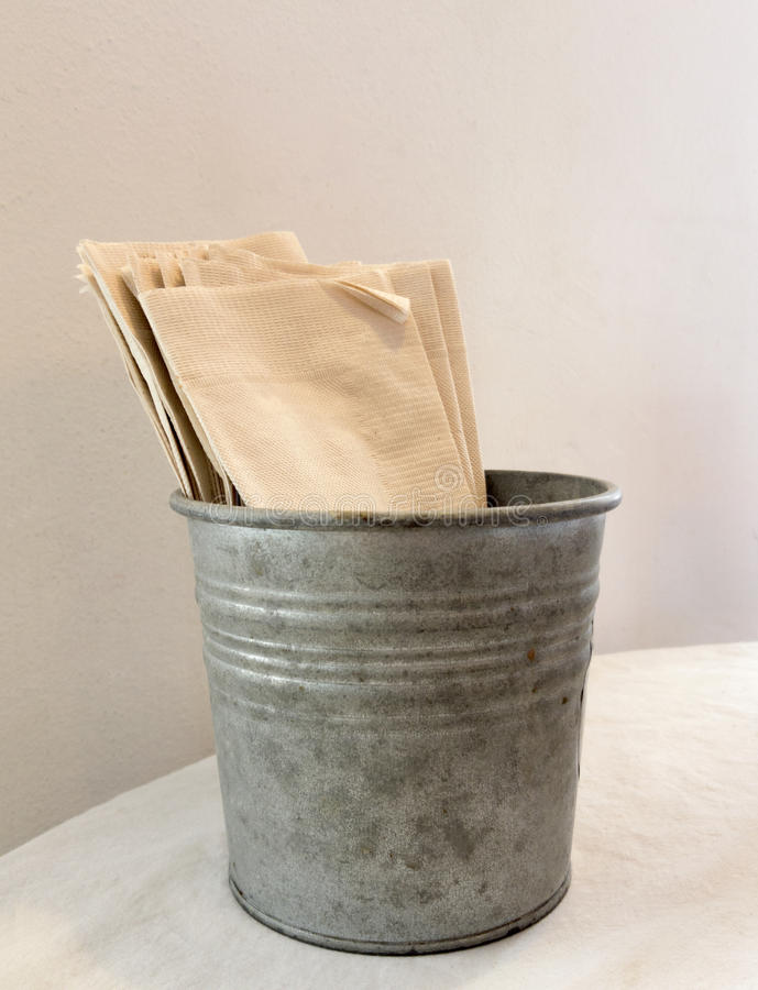 Tissue fold. In a metal basket stock photo