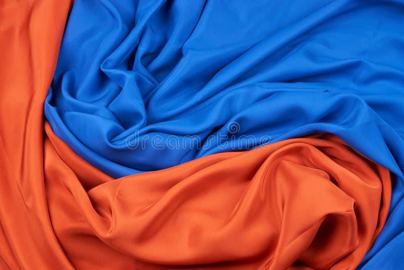 Tissus en soie oranges bleus et rouges image libre de droits
