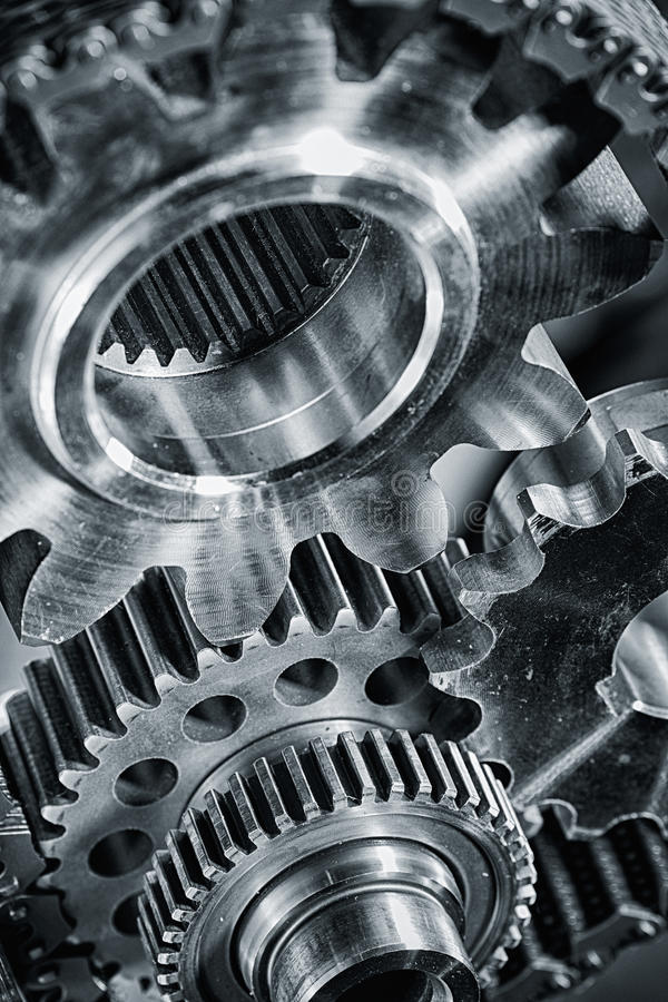 Titanium and steel aerospace gears. Large aerospace parts, gears and cogs in a special processing concept royalty free stock photography