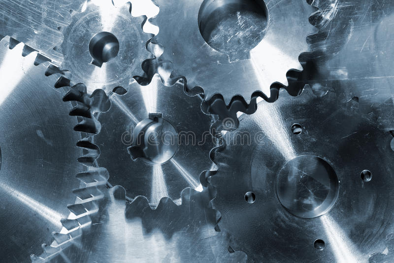 Titanium and steel gear wheels stock photography