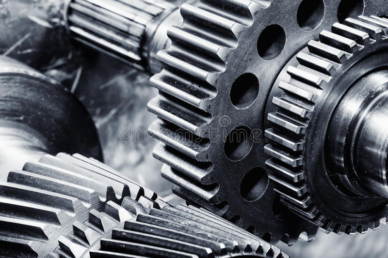 Titanium and steel gears in action. Aerospace titanium and steel gears in action, engineering parts royalty free stock photos