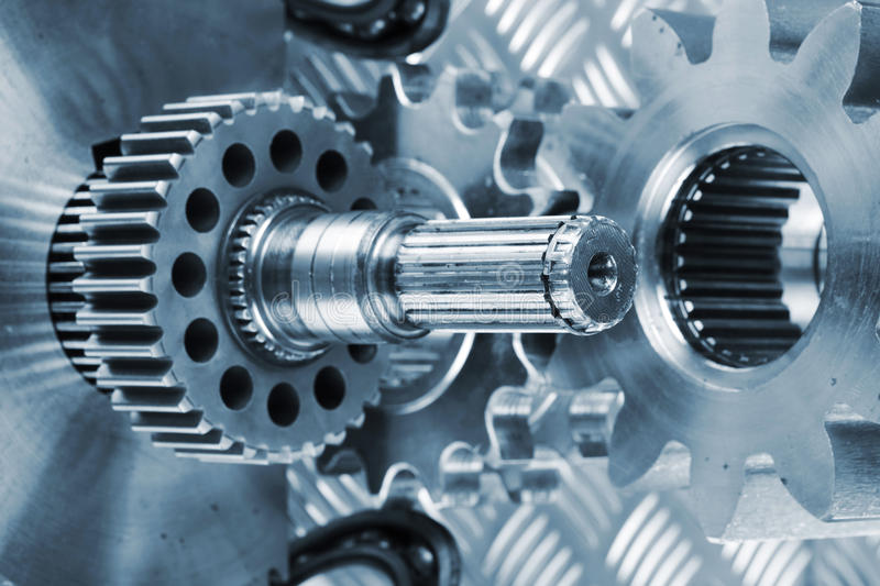 Titanium and steel gears royalty free stock photography
