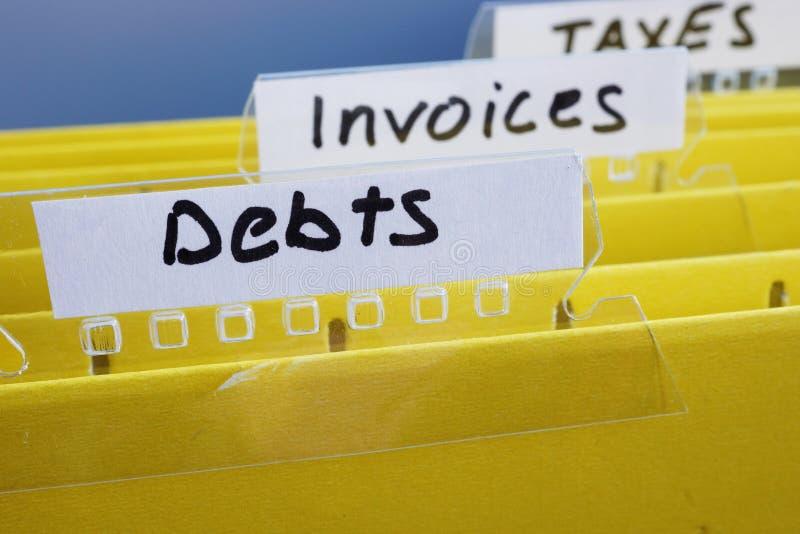 Titel-Schulden auf einem Ordner im Büro stockbilder