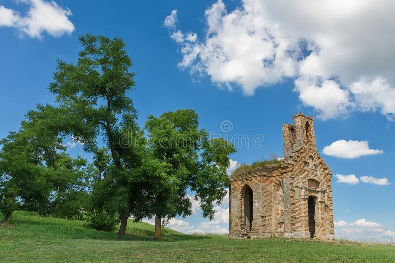 Remains of old ruined monastery church on the hill above small town of Titel in Vojvodina, Serbia stock photos