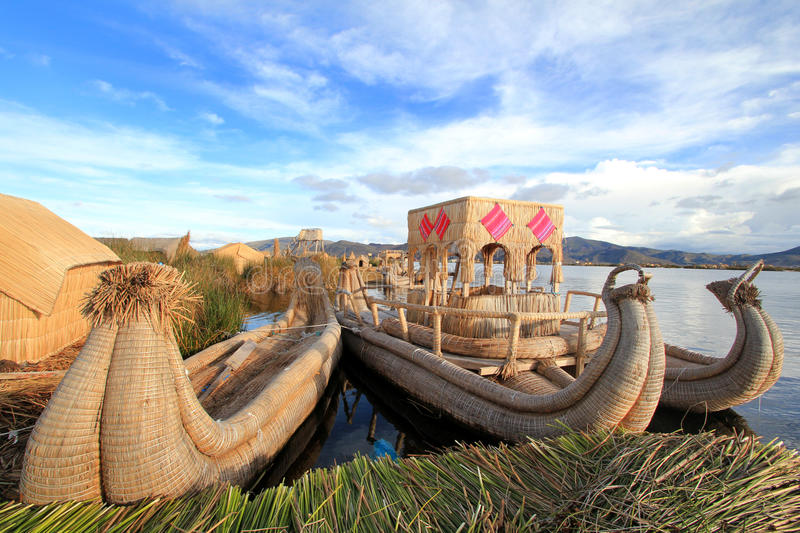 Titicaca's floating islands and boats. The boats of the Uros floating islands on Titicaca lake, at 3810 meters above sea level stock photography