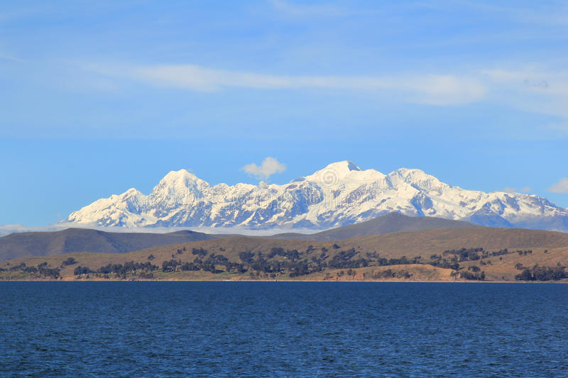 Titicaca's hills and Andes. Hills on the sides of Titicaca lake, at 3810 meters above sea level, with Andes on the background stock photography