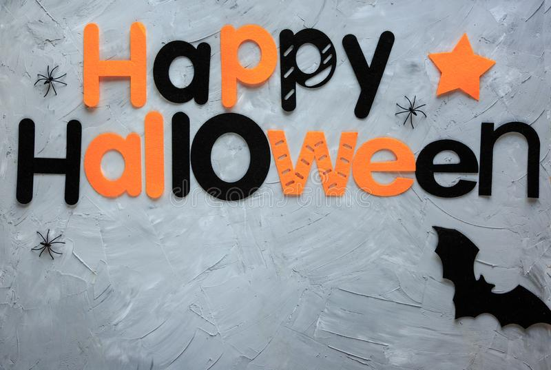 Title Happy Halloween on the gray background. Decoration, flat lay,. Top view royalty free stock photography