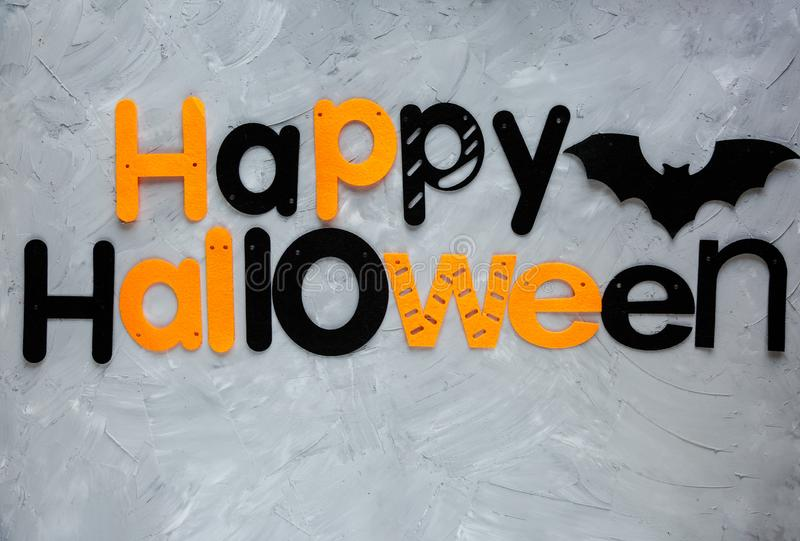 Title Happy Halloween on the gray background. Decoration, flat lay,. Top view stock images